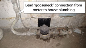 "Lead ""gooseneck"" connection from meter to house plumbing"