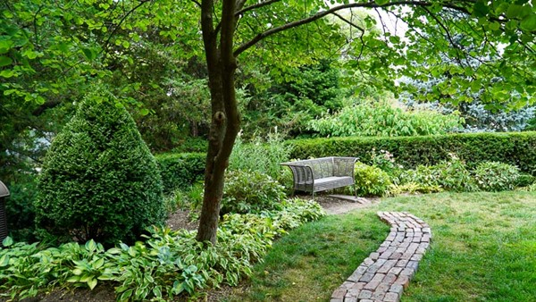 Located in the upper Healing Garden of the Sunken Gardens, this bench offers a spot for quiet reflection.