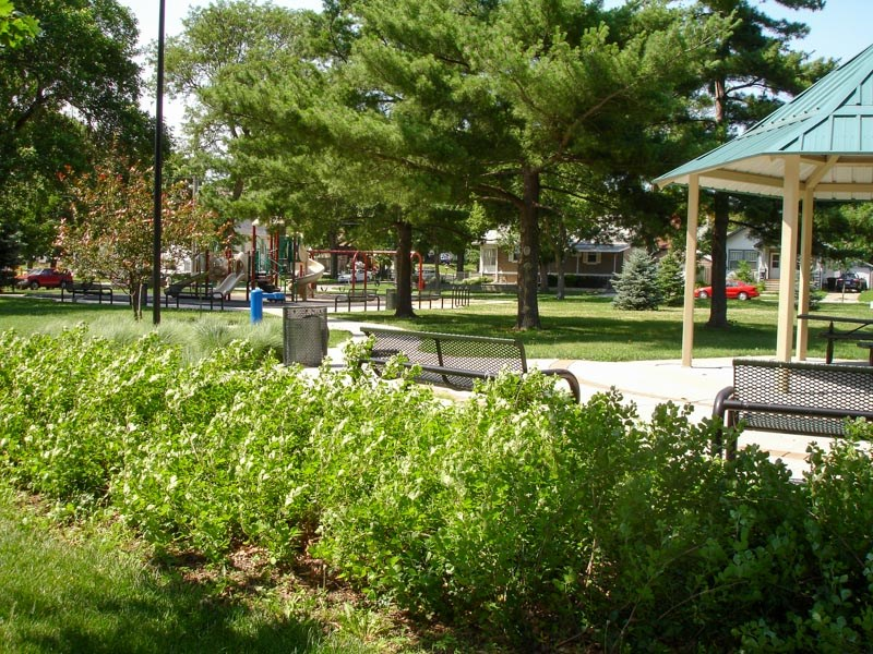 The gazebo and playground at American Legion Park are located underneath a mixture of evergreen and deciduous tree canopies. Picnic tables and benches provide ample options for picnics and relaxation.
